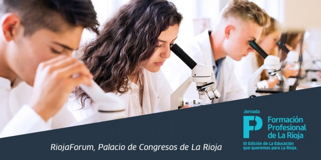 Beautiful high school students with microscopes in laboratory.